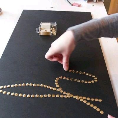 All you need is a canvas and push pins and you can do this.