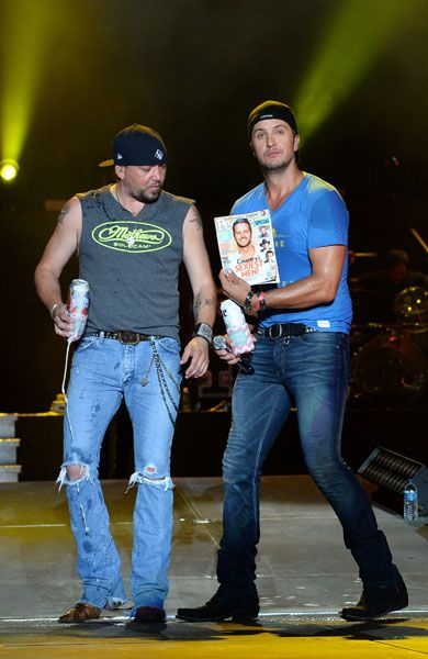 Jason Aldean (left) joins Luke Bryan during the first annual Florida Country Superfest on June 15, 2014, in Jacksonville, Fla.