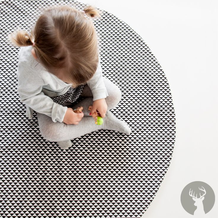 The black and white geo design play mat is so striking in an room.