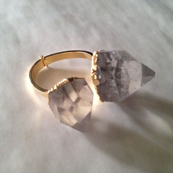 Quartz crystal ring on Etsy, $25.00 singer Taylor momsen purchased one of these in San Diego from www.aprilstardavis.com