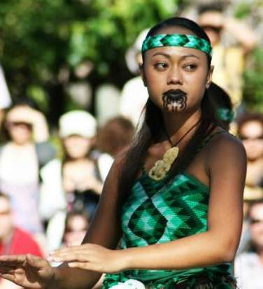 """The Maori people of New Zealand have been decorating their faces with swirling blue tattoos called """"moko"""" for centuries. Originally a sign of wealth for their ancestors, today most Maori people have moko. For women, the ultimate sign of beauty is full, blue lips and tattoos on the chin."""