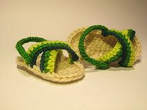 Crochet shoes for babies made by the inspiration of becoming a mother.   www.didihandmade.com