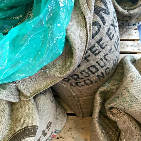 Bags of coffee beans at Theodore's Coffee in Michigan. Sales benefit the Micah House in Honduras. www.explorelocaluniverse.com