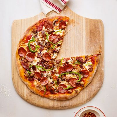 Meat Lovers' Supreme Pizza Recipe - Delish.com This loaded pizza is a decadent, rich, sausage-and-veggie-topped feast.