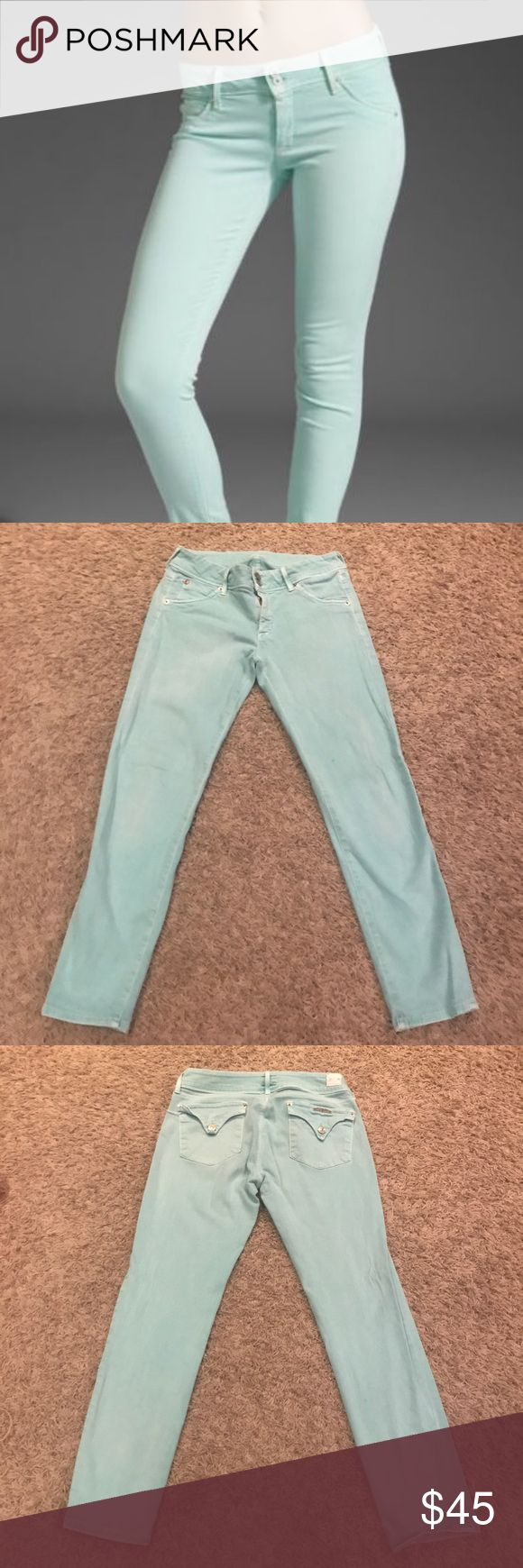 """Hudson Mint / Tiffany Blue Collin Skinny Crop Collin cut in mint (pale green) stretch denim. Distinctively Hudson elements include pointed back flap pockets, Union Jack logo, and USA construction. Low rise of approx. 7 3/4""""; wide contour waistband. Fitted through skinny legs; approx. 12"""" opening. Approx. 25"""" inseam. Front rise 8"""" Back Rise 11.5"""" Two-button/zip fly; belt loops. Cotton/Lycra®; machine wash. Made in USA of British material. Hudson Jeans Jeans Skinny"""