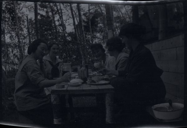 [Five women eating on a camp table] | saskhistoryonline.ca