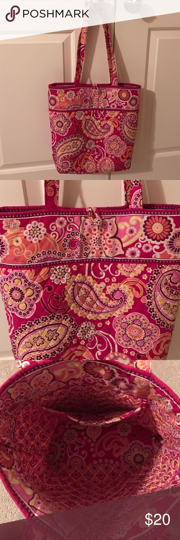 "Vera Bradley Tote Small Vera Bradley Tote Bag.  Great condition!  Has one pocket inside and a button and loop closure.  The button seems to hang loose, but I think that's the way it is made.  It is very secure.  Non smoking home.   Bag is approximately 13"" tall, 14"" wide and 4"" deep. Vera Bradley Bags Totes"
