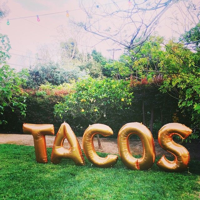 "Letter Balloon Ideas – 'TACOS'    Mylar Balloon | Statement Balloons | Letter Balloons | Balloon Sayings | Balloon Quotes | Party Décor Ideas | Party Backdrop | Photo Prop Ideas | Foil Balloon | Banners | Garlands | DIY | Hollywood    That time Reese Witherspoon's backyard ""landscaping"" consisted of a ""tacos"" balloon banner.  Link: http://www.refinery29.com/2015/06/88963/reese-witherspoon-draper-james-lifestyle#slide-11"