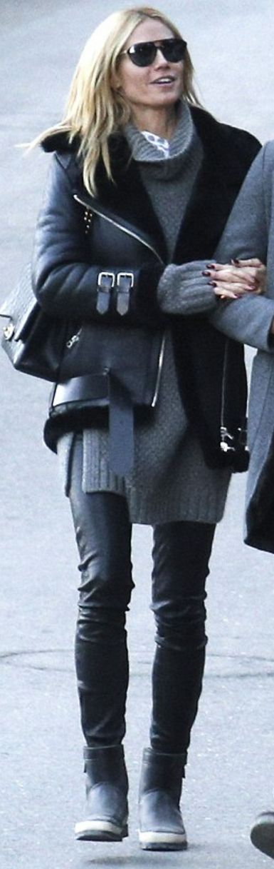Who made  Heidi Klum's black boots, shearling coat, and leather quilted handbag?