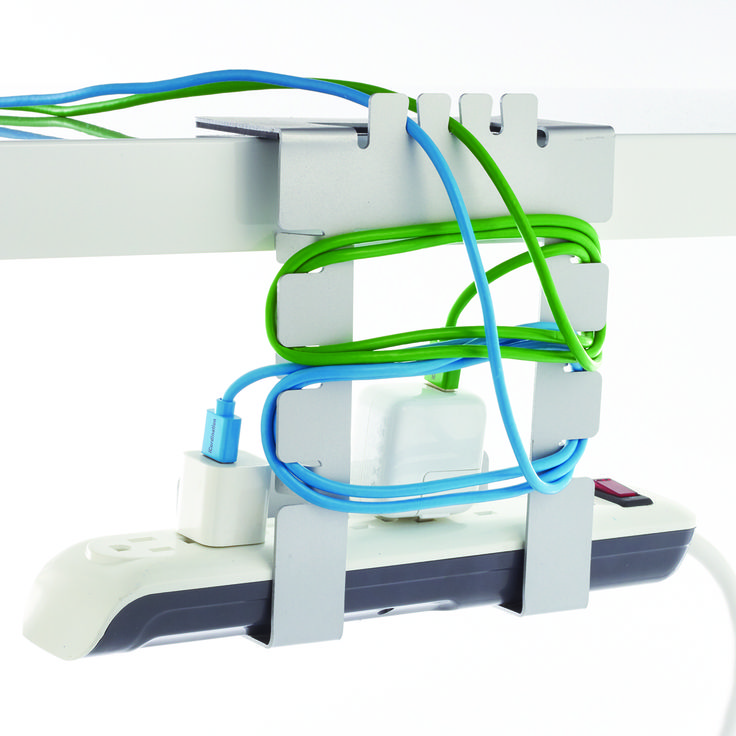 Organize all your cables, cords, power strips and more with our Hanging Cable Loft Cord Organizer! Its sturdy metal design features five grooves and six cable wrap points to organize multiple cords without jumbling them all together! A silicone strip keeps the organizer in place, yet removes cleanly without any damage to desks.  Our Hanging Cable Loft Cord Organizer is also our winning product from our partnership with Kikkerland Design and RISD!  We challenged industrial design students…