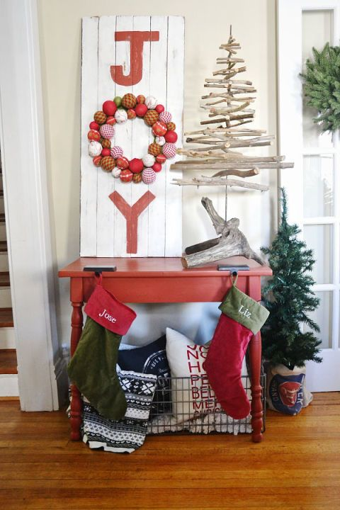"""Instead of a traditional sign that reads """"Joy"""", replace the 'O' with a wreath that incorporates all colors of the holiday. See more at Liz Marie Blog »"""