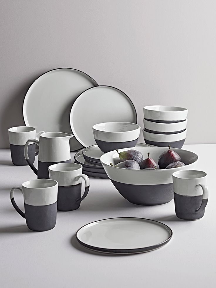Crafted from stoneware with a soft white glaze and matt black bisque edging, our stylish collection of monochrome dinnerware will look beautiful laid on your dining table or displayed proudly in a glass-fronted cabinet. The combination of colours and textures on each piece will create a unique look, whether you intend to use the collection for casual family dining or as a talking point at dinner parties. Each plate is flat, with a lipped edge, while the mugs have a gently sloped cup and…