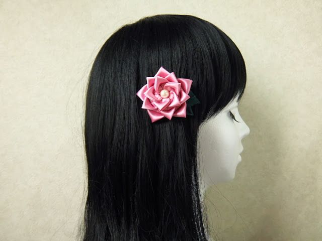 rose hair ornament with satin fabric.