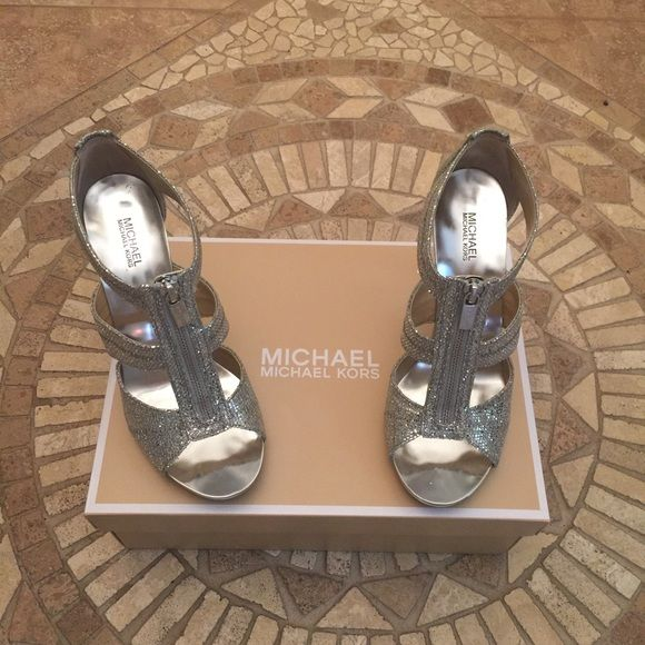 NWT Michael Kors Berkley Glitter Zip Sandal Brand new never worn (only for photo) sparkly silver zip up Michael Kors Berkley sandal. Absolutely stunning!  Perfect for a night out or a special occasion. Purchase comes with original box. Michael Kors Shoes Heels