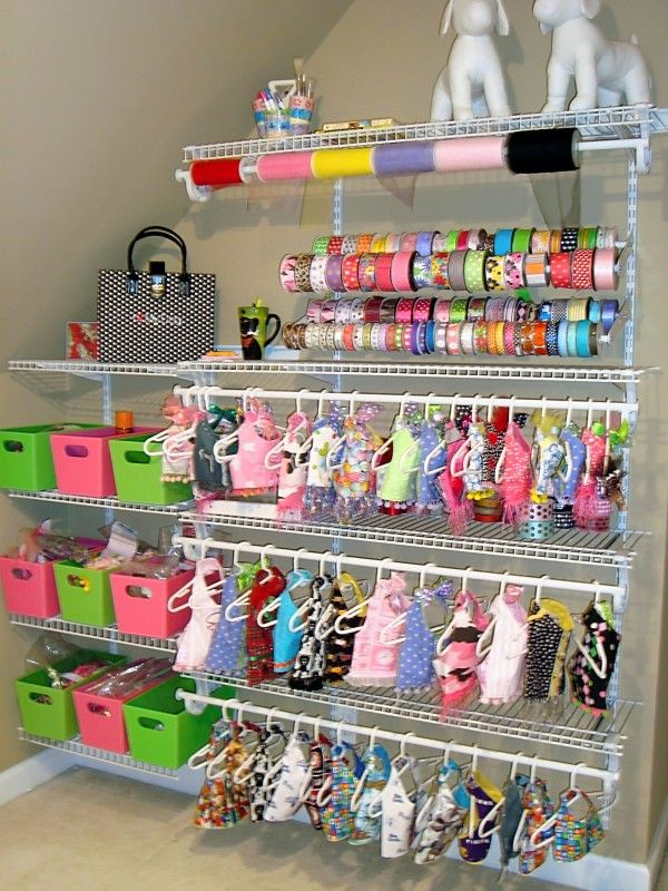 NataleesCloset doggie design studio. Closet shelving was used on a wall of the studio to hang garments and organize trim. The ribbon storage is actually shoe racks from Home Depot.
