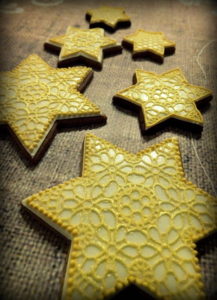 Christmas star cookies decorated with golden edible lace