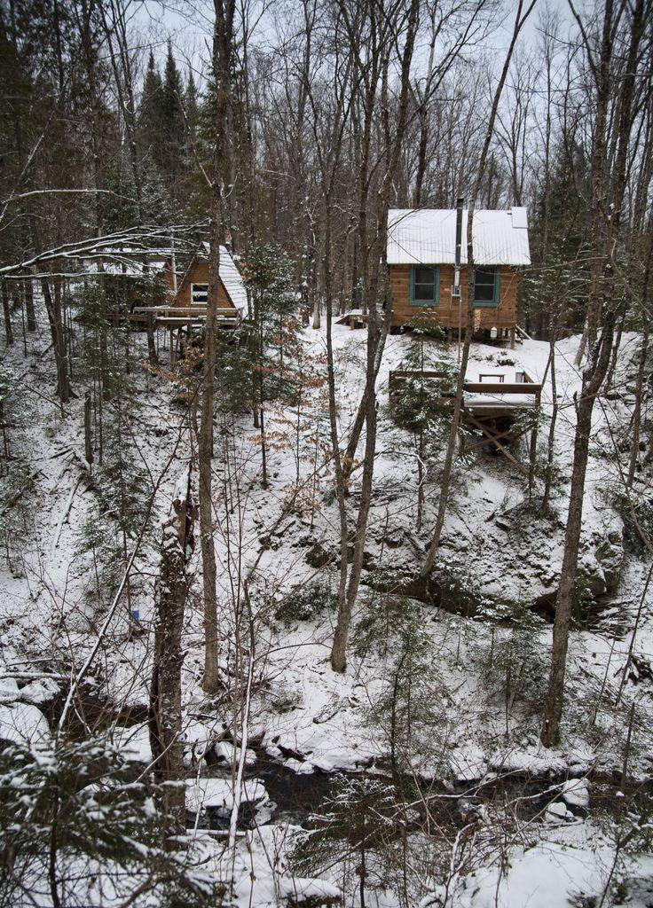 Hand hewn cabin amidst a hundred acres of minimalist for Laurentian mountains cabin rental