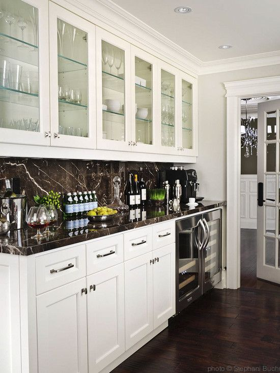 kitchens  floor to ceiling glassfront white kitchen cabinets black marble slab countertops