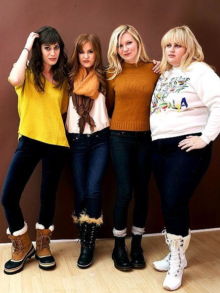 Lizzy Caplan, Isla Fisher, Kirsten Dunst and Bridesmaids's Rebel Wilson strike a pose in similar cozy sweaters and fuzzy footwear (Sorel boots on Lizzy and Isla) at the Getty Images portrait studio at T-Mobile village.