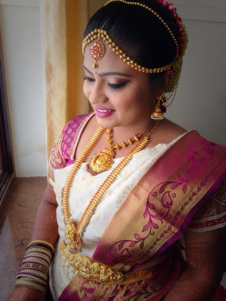 Traditional Southern Indian bride wearing bridal hair, saree and jewellery. Muhurat look. Makeup by Swank Studio. Find us at https://www.facebook.com/SwankStudioBangalore