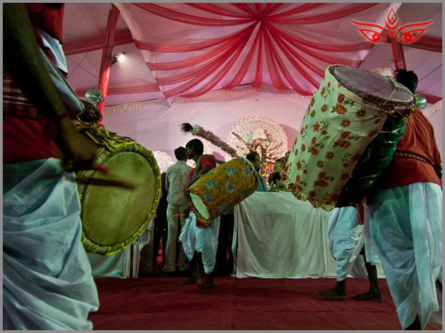 An aarti with a dhunechi dance and rythmic drumbeats dhaks, DURGA PUJA is one lively festival
