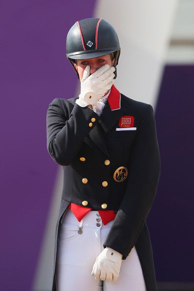 Charlotte Dujardin Photos Photos - Gold medallist Charlotte Dujardin of Great Britain riding Valegro celebrates during the medal ceremony following the Individual Dressage on Day 13 of the London 2012 Olympic Games at Greenwich Park on August 9, 2012 in London, England. - Olympics Day 13 - Equestrian