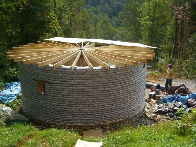 Earthbag Building: Round House.  I am thinking square house to maximize interior usable space.
