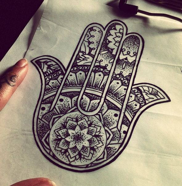 Hamsa Tattoo - The hamsa is an ancient Middle Eastern amulet symbolizing the Hand of God. In all faiths it is a protective sign. It brings it's owner happiness, luck, health, and good fortune.