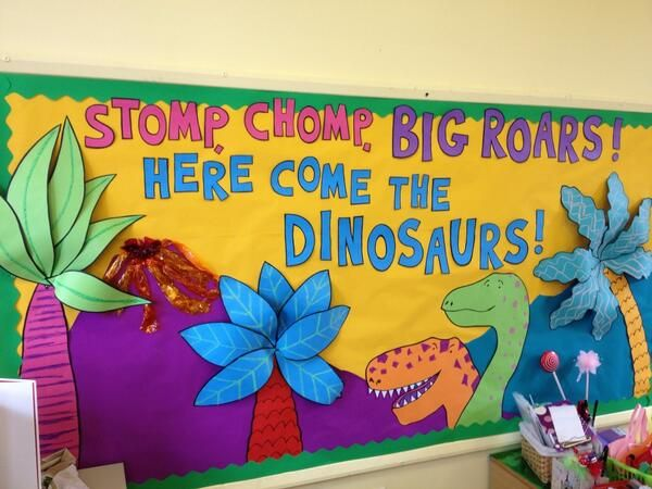 This is a super cute dinosaur bulletin board! Love how they made the plants look 3D!