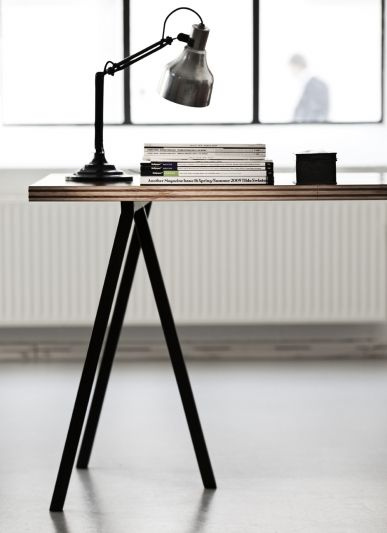 A similar look could be achieved using the Ikea Vika Lerberg legs and plywood top