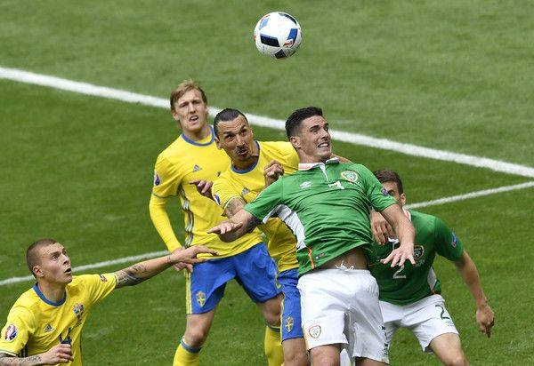 Ireland's defender Ciaran Clark (R) and Sweden's forward Zlatan Ibrahimovic vie for the ball during the Euro 2016 group E football match between Ireland and Sweden at the Stade de France stadium in Saint-Denis on June 13, 2016..The match ended in a 1-1 draw. / AFP / PHILIPPE LOPEZ