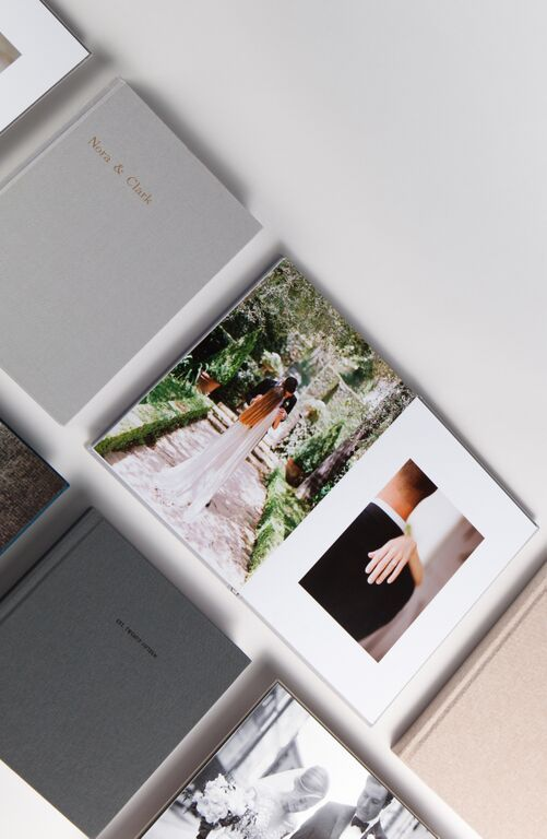 Your wedding photos in print // The Layflat Photo Album brings professional grade materials to your fingertips – offering the choice from 2 premium papers, 11 fabric colors and 4 varieties of foil-stamping. // Create yours with as few as 10 photos.