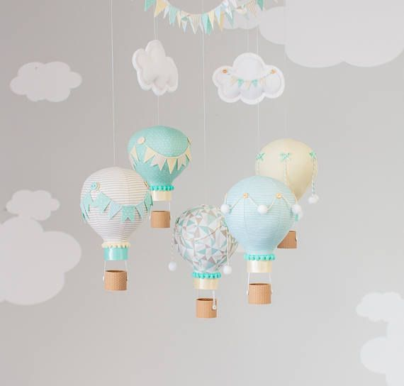 Aqua, taupe and pastel yellow gender neutral hot air balloon baby mobile nursery decoration. Tiny hot air balloons created from fabric are sewn, stuffed and embellished with little 3D printed baskets, pompoms, bows, bunting flags, buttons and trim. Each balloon is hand made in my studio. This is a great gender neutral nursery decoration for over a nursing chair, changing table or corner of the room. Truly adorable and one of a kind! BALLOON OPTIONS: 4 balloons will NOT have the bottom…