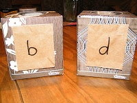 help children with number and letter reversal. Make multiple cards with two letters or numbers that are easily confused. Your child puts each card in its corresponding box. Start out helping and supervising, later as they get better at it you can just look through the piles in each box when they are done.