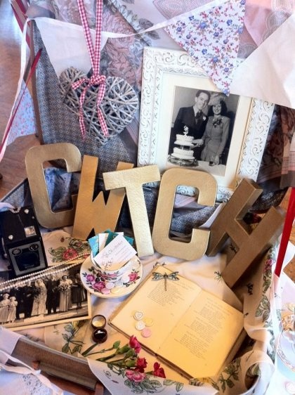 what a cute idea. vintage suitcase full of vintage wedding goodies. and a touch of welsh of course. love it.