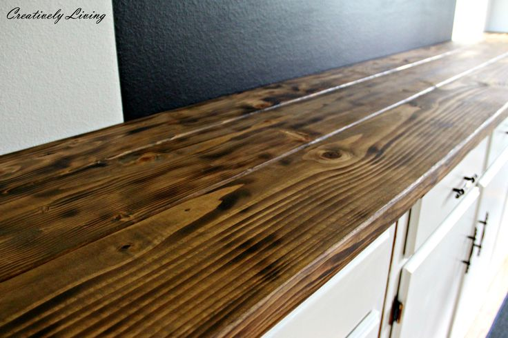 Used torched to darken.....Beautiful Rustic Built-in Coffee Bar Makeover DIY Wood Counter by Creatively Living