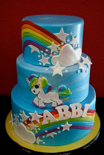 Unicorns & Rainbows by Gimme Some Sugar (vegas!), via Flickr with pink buttercream instead of covered in blue fondant