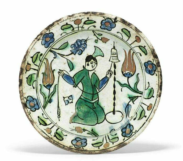 A figural Iznik pottery dish, Ottoman Turkey, first half 17th century