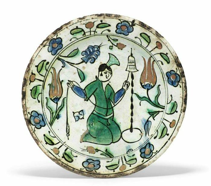A figural Iznik pottery dish, Ottoman Turkey, first half 17th century