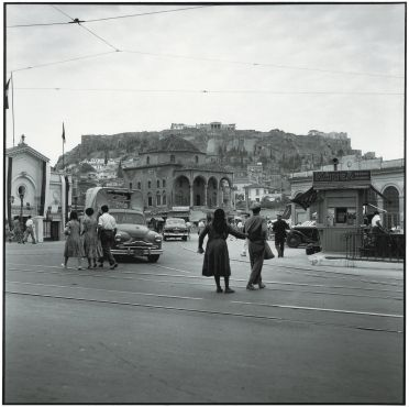 Robert McCabe, Athens 1954. Monastiraki Square. In the background the Acropolis, on the left the Byzantine church of the Pantanassa, in the center an Ottoman Mosque, and on the right the rail station. http://mccabephotos.com/
