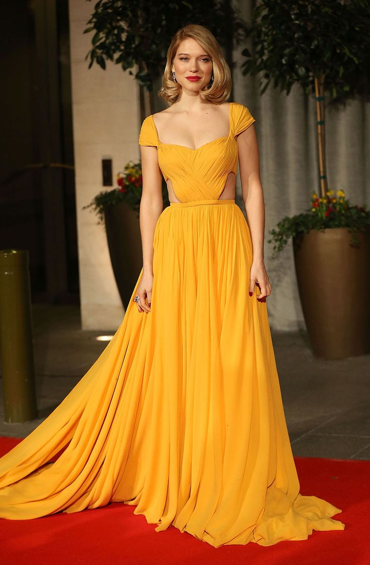 The Best Dressed at the 2015 BAFTA Awards - Léa Seydoux in Prada :: While it's no big surprise that Léa Seydoux chose to wear Prada for the big night, this golden yellow dress—paired with a deep red lip and nail—is unexpectedly stunning.