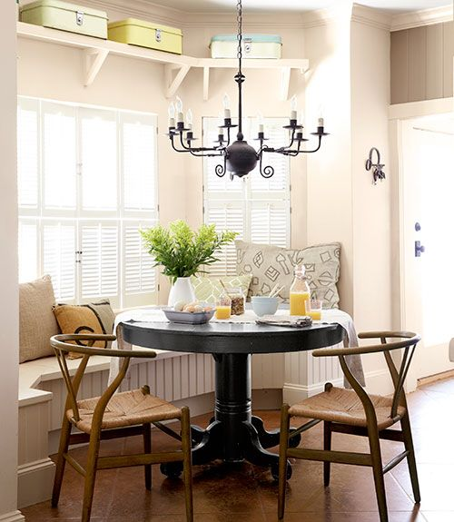 Cozy Dining Nook  A coat of paint (Beluga by Behr) refreshed this Texas ranch's flea-market table. The owner's mom brought the 1950s Hans Wegner chairs when she moved in earlier this year.  Bright idea: Vintage breadboxes provide sneaky storage for table linens.