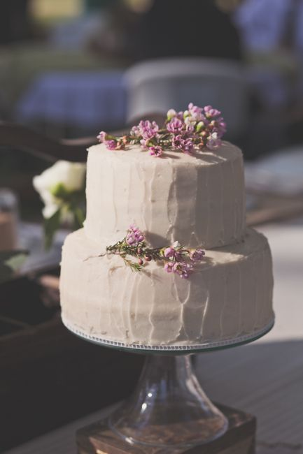 I like this simple wedding cake (with small yellow flowers) and a little bit bigger...