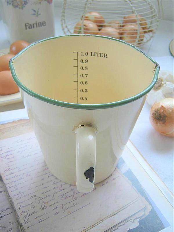 Vintage enamelware measuring cup.