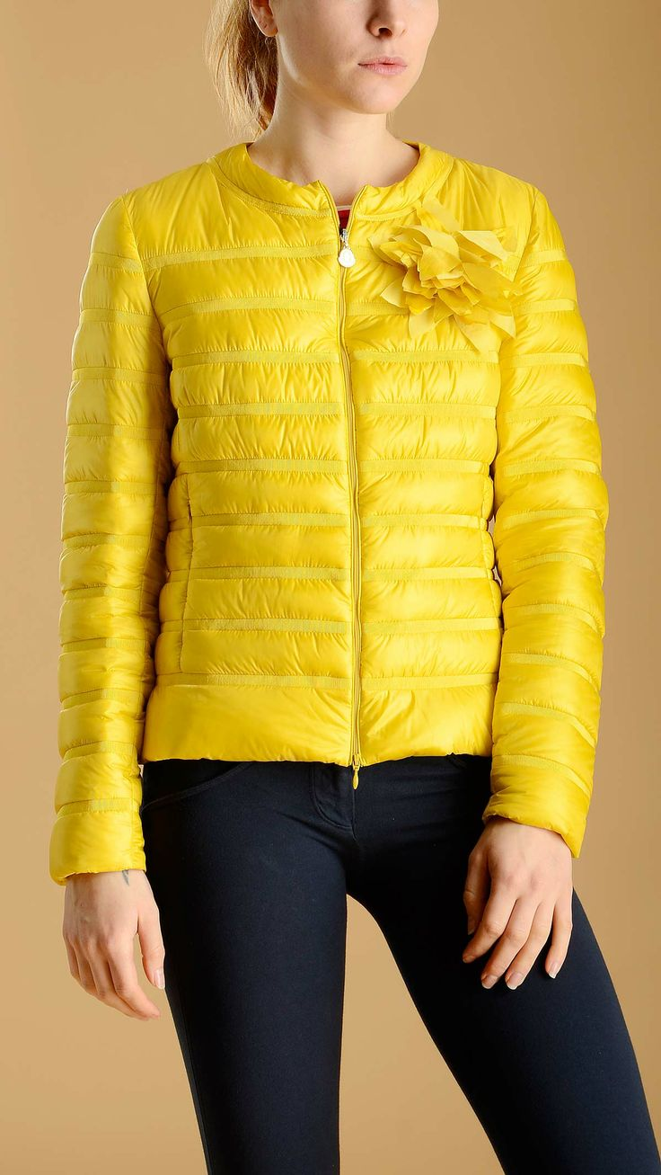 Moncler Waterproof down jacket in ultralight technical nylon featuring fabric trims, a large flower brooche, round collar, two zippered side seam pockets, goose down filling.