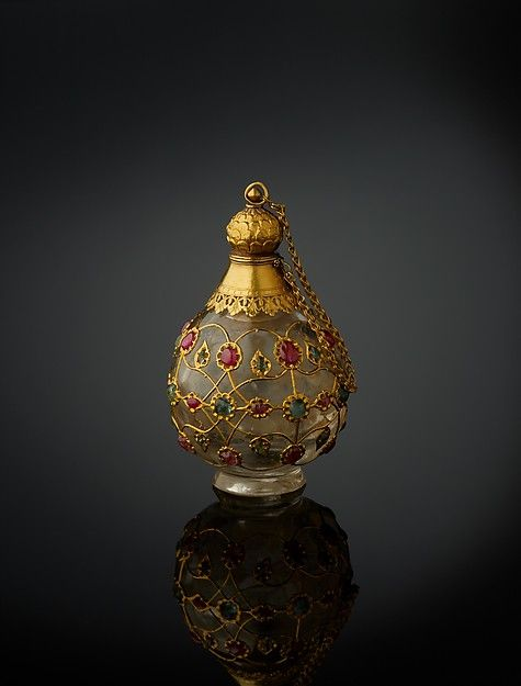 Flask Bottle Date: 1650–1700 Geography: North India Medium: Rock crystal, inlaid with gold wire, rubies, and emeralds, with gold collar, stopper, and foot Dimensions: H. 3 5/8 in. (9.2 cm) W. 2 1/8 in. (5.5 cm) Classification: Lapidary Work-Crystal Credit Line: The Al-Thani Collection