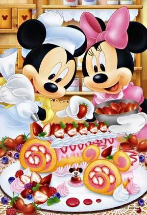 Mickey & Minnie putting finishing touches on a dessert recipe.