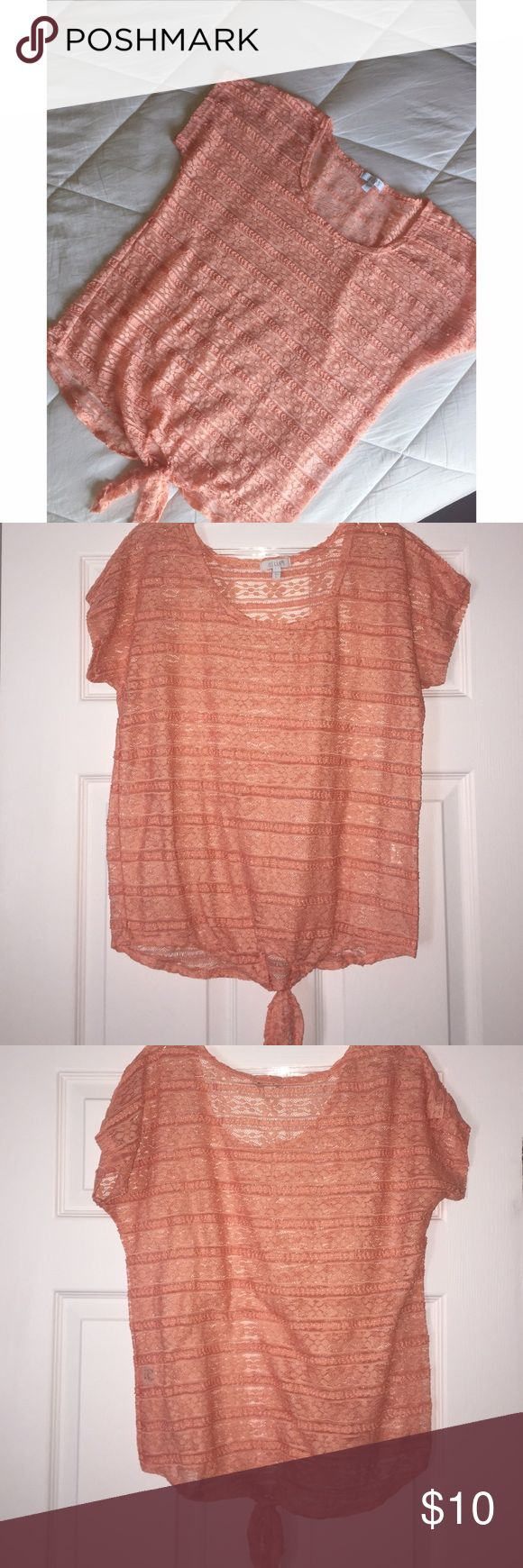 Light Peach Lace Front Knot Top This top is in EUC! Worn a few times, yet remains in pristine condition. It is a long light peach colored lace top with a front knot tied in the front. Very brisk & bohemian inspried. Size is large. Very pretty Delia's Tops