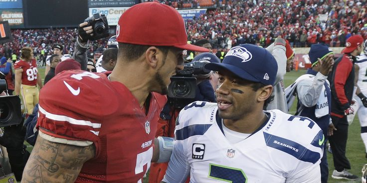 Colin Kaepernick and Russell Wilson graced the covers of this latest Sports Illustrated all greased up and shirtless. Description from geeksandcleats.com. I searched for this on bing.com/images