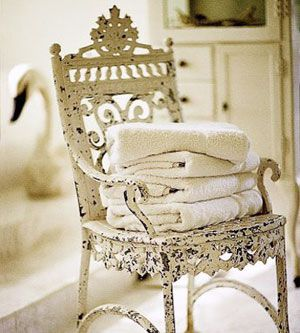 Just find a lovely little garden chair at your antique store and let it sit in your bathroom for your guest towels
